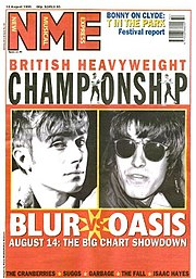 "Cover of the 12 August 1996 issue of NME advertising the ""British Heavyweight Championship"" battle between Oasis and Blur"