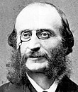 Balding, middle-aged man, with side-whiskers and pince-nez