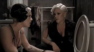 "Sober (Pink song) - Pink and her doppelgänger in the bathroom at a party, in the video for ""Sober""."