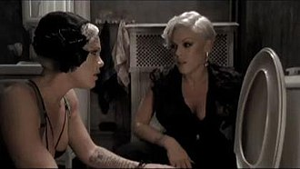 """Sober (Pink song) - Pink and her doppelgänger in the bathroom at a party, in the video for """"Sober""""."""