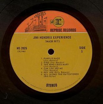 "Reprise Records - ""Two-tone orange"" label used by Reprise during the Warner Bros.-Seven Arts merger from 1968 to 1969. (Label to Jimi Hendrix's Smash Hits.) After the Kinney National Company took over Warner Bros. in 1969, the orange tone at the top of the label was changed to the same tone as on the rest of the label, the W7 box logo was removed and the circled :r logo became a boxed logo without the ""Reprise"" designation."