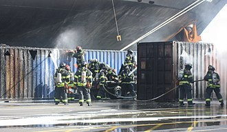 Seattle Fire Department - Seattle firefighters put out a cargo container fire in the Port of Seattle.