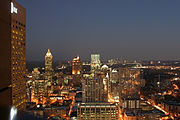 Midtown Atlanta at night, with Buckhead and Sandy Springs visible in the distance.