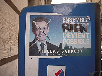 "2007 French presidential election - A pro-Sarkozy sticker, after being defaced, in Paris, France. (Translation: ""Together, NOTHING is possible."")"