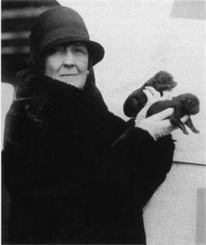 Carrie Fulton Phillips - Image: Portrait of Carrie Fulton Phillips holding two puppies