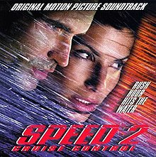 "The faces of Jason Patric and Sandra Bullock and shown among streaks of diagonal lines in blue and orange. In white text, the top reads ""Original Motion Picture Soundtrack"" and right side reads ""Rush Hour Hits the Water"". The bottom reads ""Speed 2"" and ""Cruise Control"" in red text."