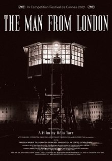 "A shadowy figure stands at the window of an illuminated hexagonal viewing tower with a ladder in front for access. The surroundings are darkened with the exception of dimly lit multi-storey buildings in the background. Above the tower in capital letters the title of the film, THE MAN FROM LONDON, appears accompanied by a note reading ""In Competition Festival du Cannes 2007"" with the festival's logo on either side. At the foot of the poster, below the tower, the film's production credits are superimposed. and below it is listed the production credits."
