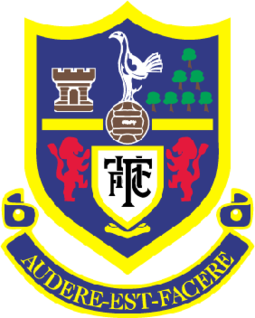 Between 1956 and 2006, the club crest featured a heraldic shield, displaying a number of local landmarks and associations Tottenham Hotspur old logo.png