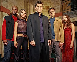The principal Angel actors portraying their characters, from left to right: Gunn, Cordelia, Angel, Wesley and Fred
