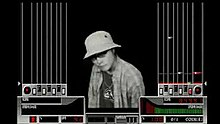 "A person wearing a hat is seen at the center of the screen, depicted with monochrome colors over a black background. The left and right sides of the screen contain lanes for notes heading toward the controller's seven keys and turntable. The player's score and groove gauge are at the bottom side of the screen alongside a percentage accounting for the player's overall performance, a red dancer, the song's bpm, ""surround"", and ""0/1 coin(s)""."