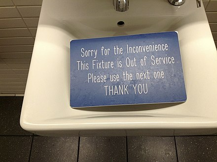 A bathroom sink fixture out of order