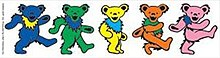 Five differently-colored cartoon teddy bears march in line.