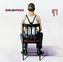 In a white room, a young man in a white shirt with suspenders sits in a chair facing away from the world. The band's name is to the left of his head while the album's name is to the right, in red.