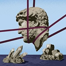 The head of a statue facing left, supported by purple cables in mid-air, is set against a pale blue sky and is the centre of the picture. Below it in the dark blue foreground are crystalline rocks, which point towards the head.