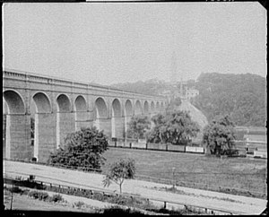 John B. Jervis - The High Bridge over the Harlem River, part of the Croton Aqueduct, as seen in 1890.