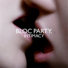 "Album cover showing a close-up of a couple kissing, captioned ""BLOC PARTY."" and (smaller) ""INTIMACY"" below it. Only the lower, central portions of the heads are visible."