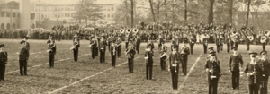 Rockwell Field (Kent State) - View of the KSU Marching Band at Rockwell Field in 1937. The original heating plant and Merrill Hall can be seen in the background