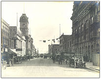 Corner of South Railway Street (later renamed Saskatchewan Drive) and Scarth Street looking south, circa 1915. Note old Post Office at Scarth Street and 11th Avenue on left.