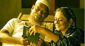 Adaminte Makan Abu - Salim Kumar and Zarina Wahab as Abu and Aishumma, holding their new passports
