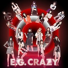 "19 Japanese women (E-girls) all placed in random areas in front, and behind, white and red neon-lit circles. The title ""E.G. Crazy"" is placed at the bottom, which is tinted pink."
