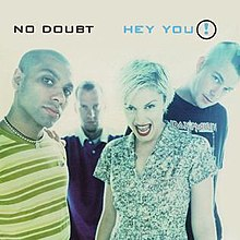 The artwork portrays the four main band members of No Doubt standing in a brightly-lit room.