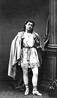 photograph of young woman in a male Ancient Greek costume