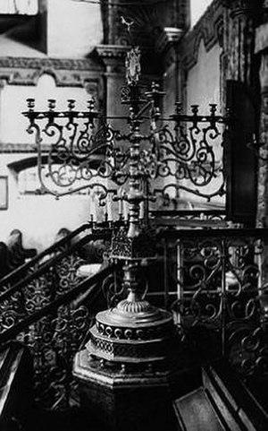 Zamość Synagogue - A large menorah next to the Aron Kodesh.