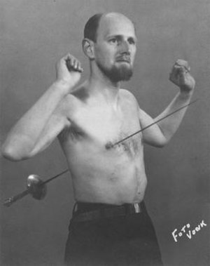 Mirin Dajo - Promotional photograph of Mirin Dajo showing a rapier piercing his thorax from back to front