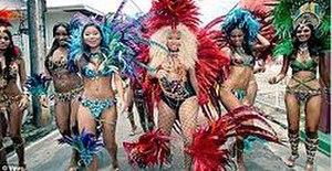 Pound the Alarm - Minaj dresses in carnival attire throughout the video.