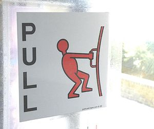 Pictorial push pull signs for doors