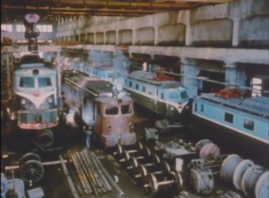 Kim Chong-t'ae Electric Locomotive Works - Several Red Flag class locomotives in various stages of completion, circa 1989