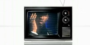 OMG (Usher song) - A still from the video, showing the first scene with Usher on a flickering television, paying homage to Max Headroom