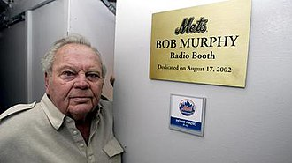 Bob Murphy (sportscaster) - Murphy in front of the radio booth at Shea Stadium named in his honor. The radio booth at Citi Field is identically named.