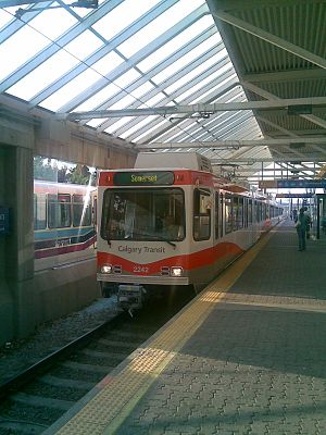 Calgary Transit - Train in new red and white livery arriving at Anderson Station
