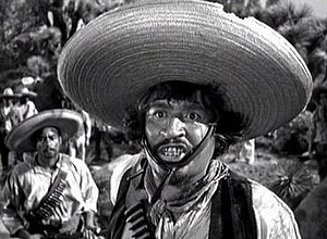 "Stinking badges - A Mexican bandit leader named ""Gold Hat"" (portrayed by Alfonso Bedoya) tries to convince Fred C. Dobbs (Humphrey Bogart) that he and his company are Federales in The Treasure of the Sierra Madre"