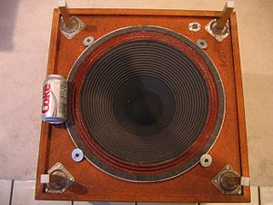 Subwoofer - View of the underside of the downward-firing Infinity Servo Statik 1, showing the size of the 18-inch (45cm) custom-wound Cerwin Vega driver in relation to a can of Diet Coke, to show scale