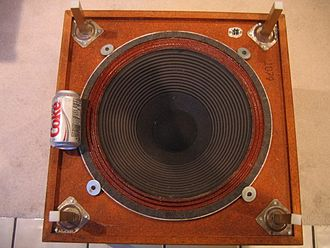Subwoofer - View of the underside of the downward-firing Infinity Servo Statik 1, showing the size of the 18-inch (45 cm) custom-wound Cerwin Vega driver in relation to a can of Diet Coke, to show scale