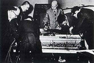Fluxus - Piano Activities, by Philip Corner, as performed in Wiesbaden, 1962, by (l-r) Emmett Williams, Wolf Vostell, Nam June Paik, Dick Higgins, Benjamin Patterson and George Maciunas