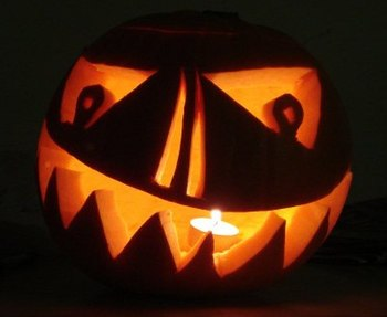 A pumpkin carved into a jack-o'-lantern for Ha...
