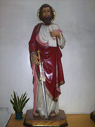 A statue of Paul holding a scroll (symbolising the Scriptures) and the sword (symbolising his martyrdom) Saint Paul with a Scroll and a Sword.jpg