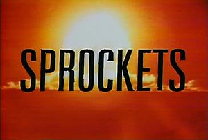 Sprockets (Saturday Night Live) - Title card from Saturday Night Live's Sprockets, with the title superimposed over the flash of a nuclear explosion.