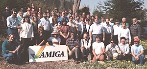 Carl Sassenrath - Amiga Team, 1985 (Sassenrath in plaid shirt to right of sign)