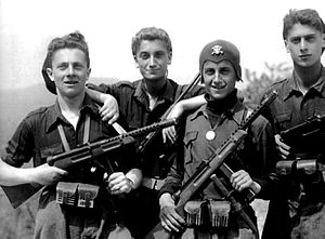 Black Brigades - Soldiers in Black Brigades, holding submachine guns. Note: the smiling soldier, wearing the unusual-looking, skull cap hat, with a huge skull insignia on the front.