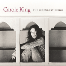 "The album cover, with a young Carole King seated in a grainy, old photo, with the words ""Carole King"" and ""The Legendary Demos"" above her."