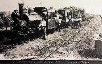 Rail transport in Puerto Rico - Early 20th century train hauling wagons filled with sugar cane, in the Central Lafayette refinery in Arroyo, Puerto Rico.