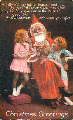 postcard of father christmas with two children
