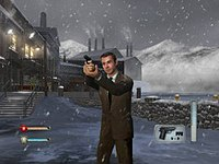 A man in a suit holding a gun. It is snowing, and a factory is on the background. On the bottom corners icons indicating ammo and health of the player can be seen.