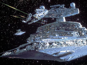 Star Destroyer - A pair of Imperial II-class Star Destroyers and a squadron of TIE fighters pursue the Millennium Falcon.