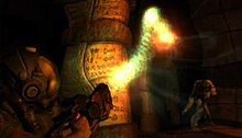 A nondescript figure stands in the foreground, holding a gun which is emitting a rope-esque beam of light which appears to be manipulating the matter around it.