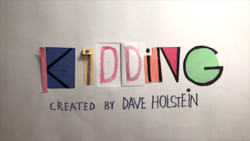 "Multiple pieces of paper with the text ""KiDDiNG / CREATED BY DAVE HOLSTEiN"" (""/"" = newline character)"